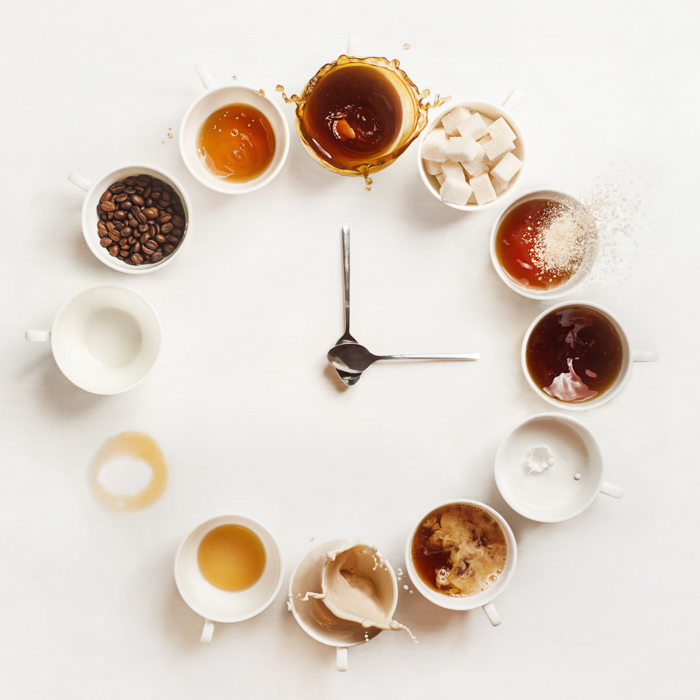 Still life photography ideas clock composition made of coffee cups