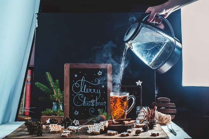 A christmas still life photography shot of hot drinks and steam